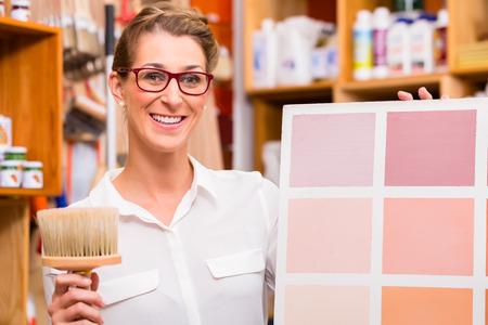 interior designers: Interior Designer with paint sample card