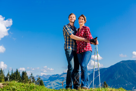 nordic: Couple enjoying view hiking in the alpine mountains