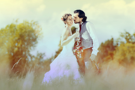 Wedding couple bride and groom on meadow photo