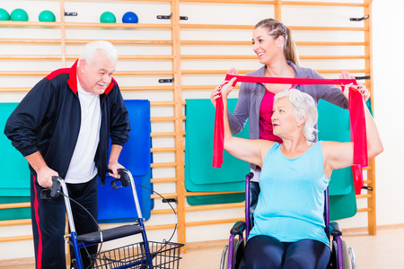 rehab: Seniors in physical rehabilitation therapy with trainer