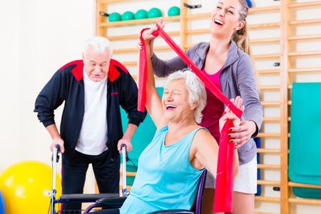 medical people: Seniors in physical rehabilitation therapy with trainer