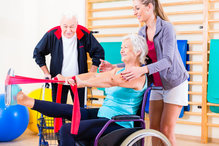 and activities: Seniors in physical rehabilitation therapy with trainer