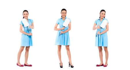 Asian hotel maid or cleaning lady, compositing of three scenes, isolated on white background Stock Photo