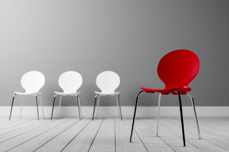 red chair: Three white and a red chair, Concept for creative, outstanding leadership