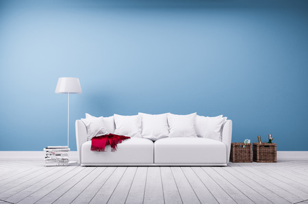 minimalist apartment: Sofa and floor lamp in front of blue wall, interior rendering Stock Photo