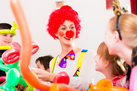carnival clown: Clown at children birthday party entertaining the kids