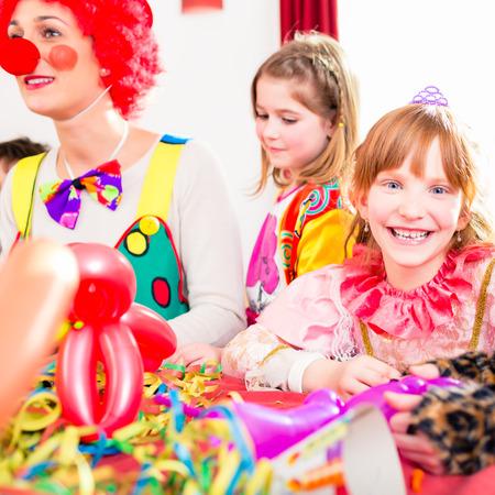 kids birthday party: Clown at children birthday party entertaining the kids