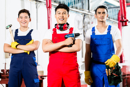 Industrial workers: Team of Workers with tools in Asian industrial factory