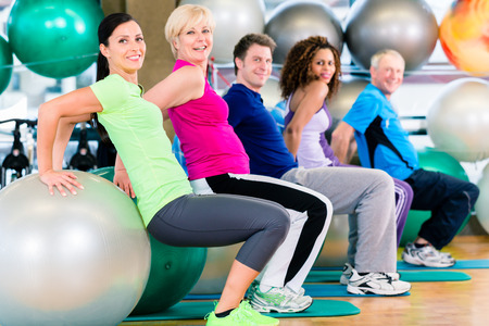 Men exercise: Group of young and senior people exercising in gym, diversity group of and white people Kho ảnh