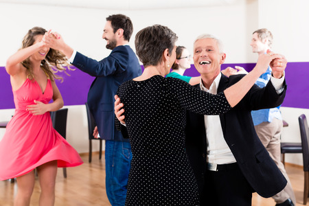 seniors: Group of people dancing in dance class having fun