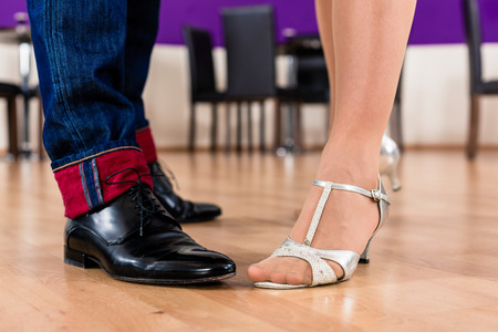 training shoes: Woman and man with her dancing shoes in dance school