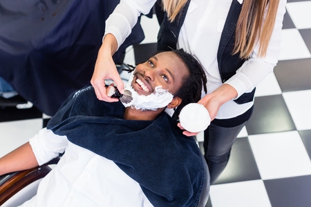 barber: Customer at barber shop with shaving cream