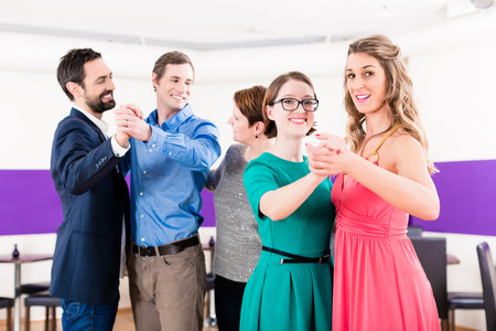 Dance instructor with gay couples in dancing class Stock Photo