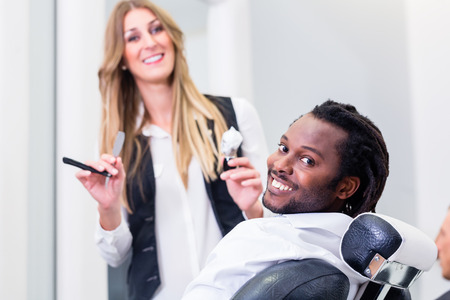 Caucasian woman: Happy barber and smiling customer in salon Stock Photo