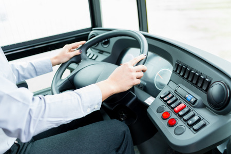 driver: Bus driver in cockpit at the wheel driving