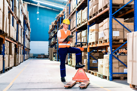 industrial: Asian man in industrial warehouse checking list
