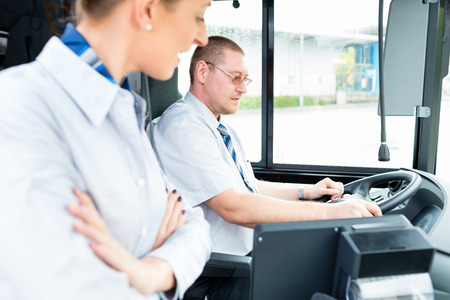 coach bus: Bus or coach driver and tourist guide Stock Photo