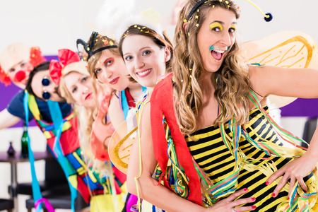 costumes: Party people celebrating carnival or new years eve