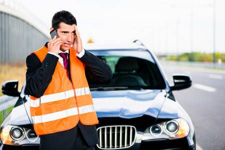 breakdown: Man with car breakdown calling towing company Stock Photo