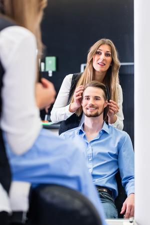 haircutter: Haircutter cutting hair, shot in mirror