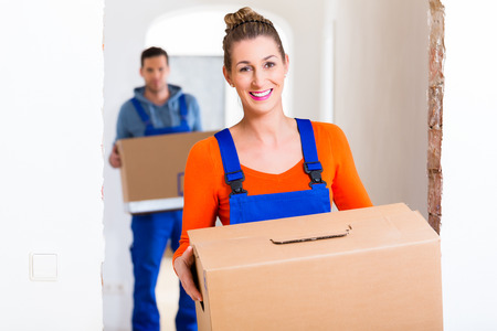 moving out: Woman and man moving in new home with boxes Stock Photo