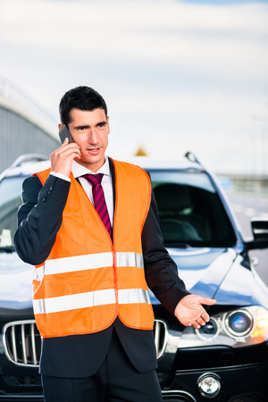 car breakdown: Man with car breakdown calling towing company Stock Photo