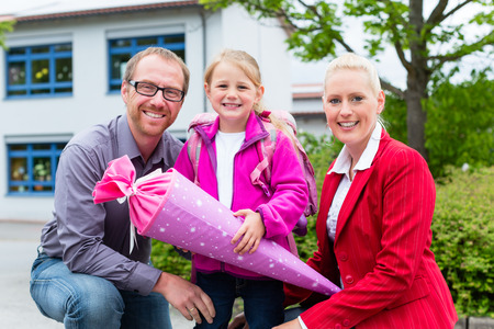 first day of school: Family bringing daughter to first day at school Stock Photo