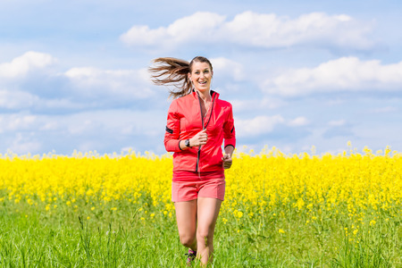 woman running: Woman running for better fitness in spring