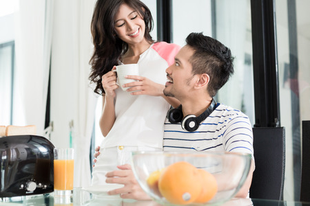Asian couple, woman and man, having breakfast with toast and coffee Stock Photo