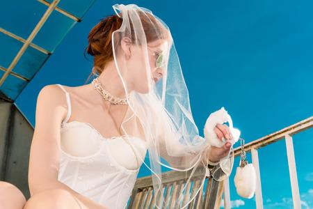Bride in lingerie for her wedding dreaming