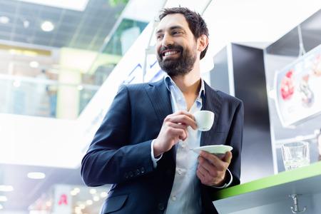 espresso: man enjoying espresso in cafe