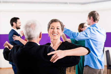 mature people: Group of people dancing in dance class having fun