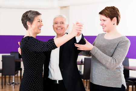 instructors: Dance instructor with senior couple of woman and man Stock Photo