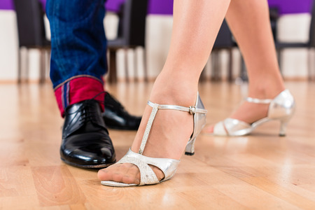 contemporary dance: Woman and man with her dancing shoes in dance school
