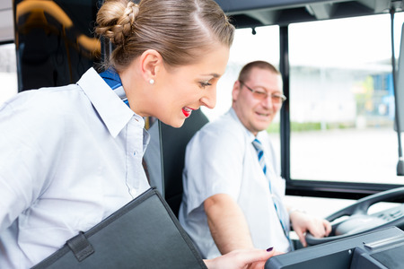 tourist guide: Bus or coach driver and tourist guide Stock Photo