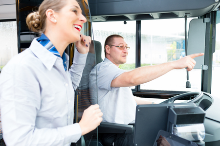 guide: Bus or coach driver and tourist guide Stock Photo