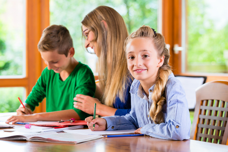 mom son: Private teacher giving lessons at home, books are on the table