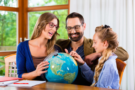 assignment: Parents helping daughter with homework assignment