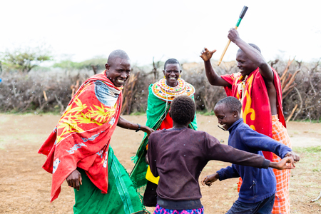 Massai family celebrating and dancing