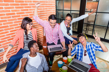 university students: Creative students with aspirations having success being happy Stock Photo