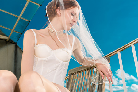 sexy bride: Bride in lingerie for her wedding dreaming