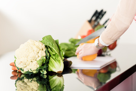 clean home: Woman preparing food cutting vegetables Stock Photo
