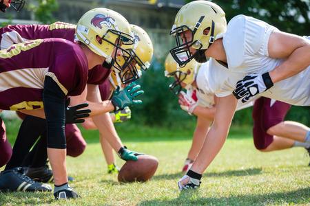 jugadores de futbol: Partido de fútbol americano - ataque en curso
