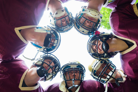 huddle: American Football Team having huddle in match Stock Photo