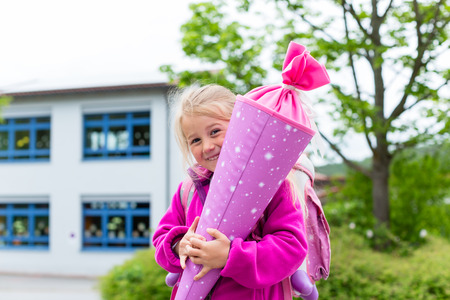 Student at first day in school with traditional candy cone