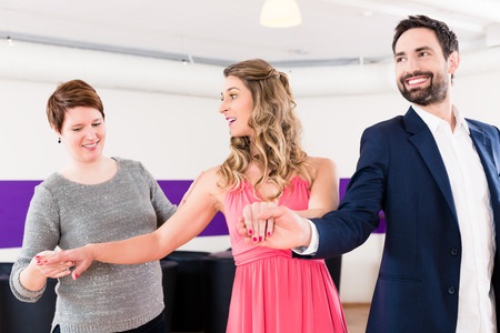 dances: Instructor in dance school with couple of man and woman