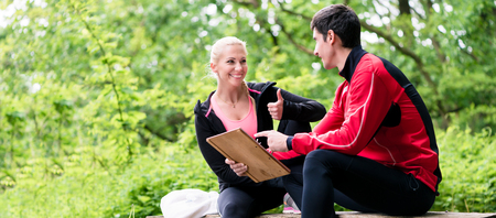 trainers: Woman with personal trainer at running evaluation