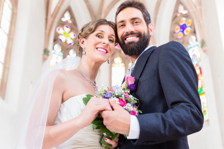 marrying: Bridal couple in church having wedding