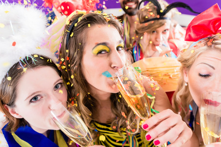 carnival masks: People on party drinking champagne and celebrating birthday or new years eve