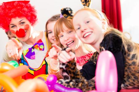 Clown at children birthday party entertaining the kids